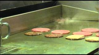 Frying Cheesburgers At Billy Goat Tavern - Bucket List Bars