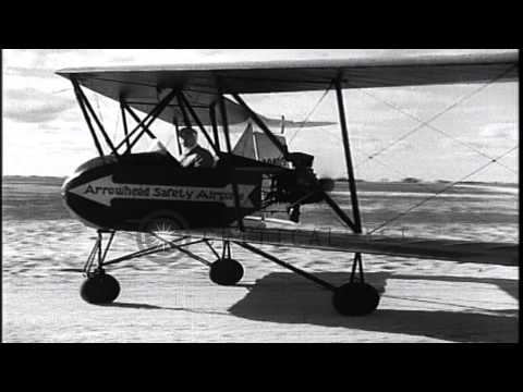 Arrowhead Safety Plane of 1930's flying in the air. HD Stock Footage