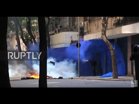 Brazil: Police fire rubber bullets in clashes with anti-austerity protesters