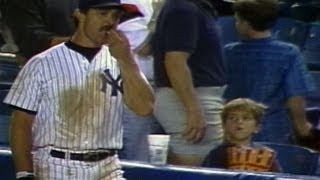 Don Mattingly helps himself to a young fan