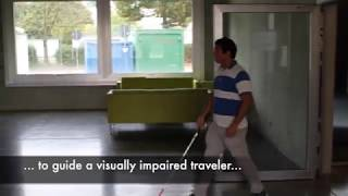 DroneNavigator: Using Leashed and Free-Floating Quadcopters to Navigate Visually Impaired Travelers