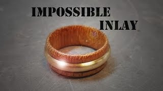 Wooden ring with brass inlay / Puinen sormus messinkiupotuksella