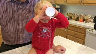 Baby Michael Attempts to Drink From a Cup