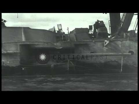 Views of wrecked USS Utah and USS Arizona soon after Japanese attack on Pearl...HD Stock Footage