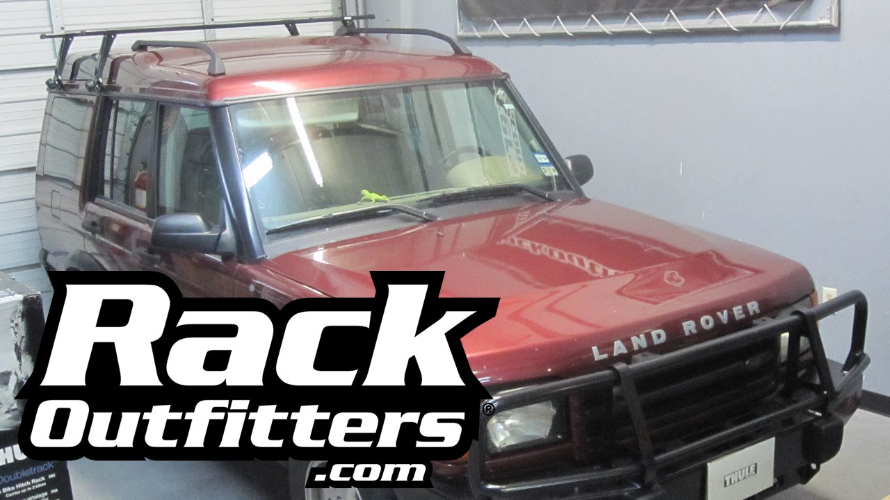 land rover discovery with thule gutter foot square bar base roof rack by rack outfitters