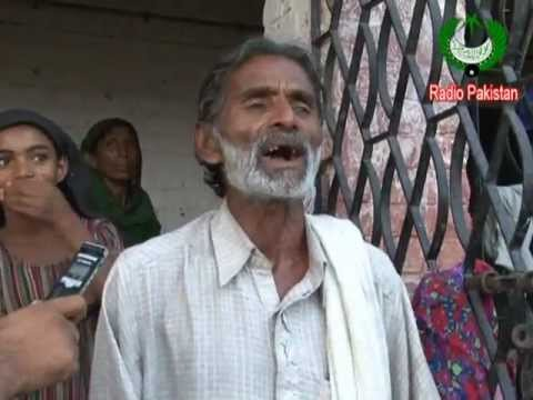 Sindh Flood - Wazir Ali Qambrani  Local Folk Singer From Sindh (Report) 2011.flv
