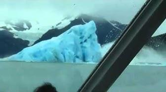 Iceberg flips over, very surreal!