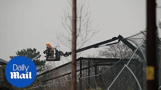 Firefighters use a crane to put snuff out fire at Chester Zoo