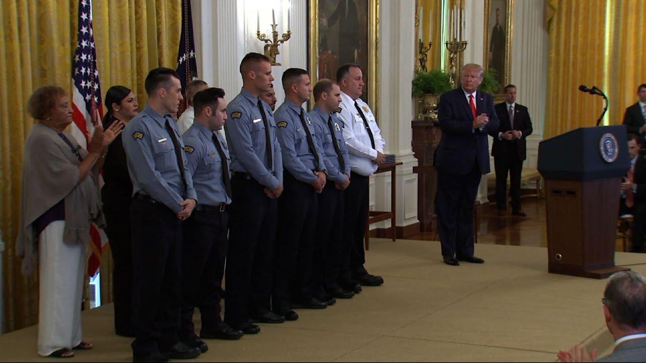 Trump presents medal to mass shootings responders