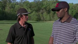 Rickie Fowler gives Reggie Bush a golf lesson