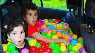 kids play with balls in daddy's car