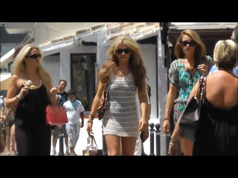 Puerto Banus, Marbella Spain. By day; by night. Supercars, beautiful people, restaurants.