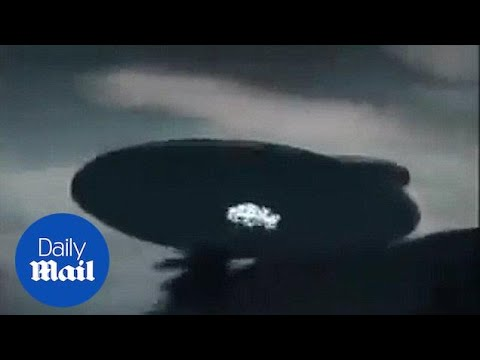 Bizarre footage from Malaysia shows giant UFO hovering - Daily Mail