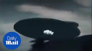 Bizarre footage from Malaysia shows giant UFO hovering - Daily Mail.. WOW!!!