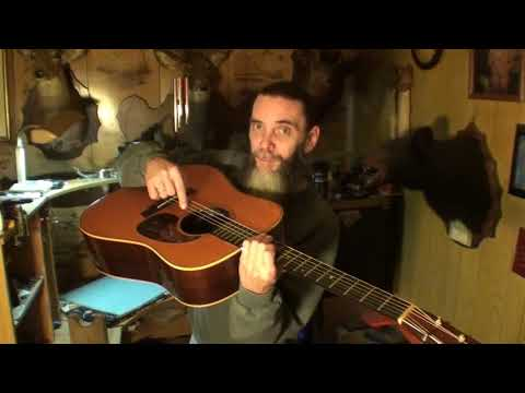 acoustic guitars enlarged sound hole?
