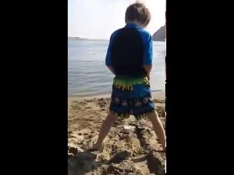 Boy PEES on public beach in broad daylight!