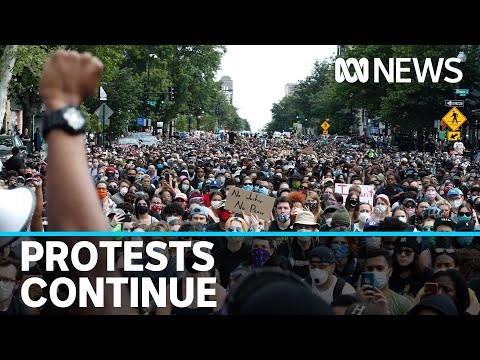 Thousands stand defiant