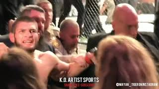 KHABIB SCREAMS AT IRISH FANS CAGESIDE RESTRAINED AFTER JUMPING DANIS!