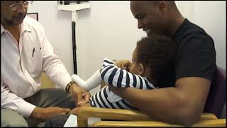 Babies laughing at doctor's office getting a shot.