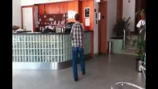 Armless Crackhead Trashes Hotel Reception
