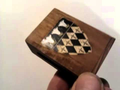 EDWARDIAN WOODEN MATCHBOX HOLDER with COAT of ARMS of MAGDALEN COLLEGE OXFORD.