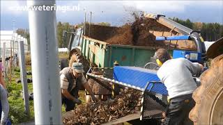 Bio Chopper PTO tractor driven shredder chopping strawberry plants and coir substrate to compost