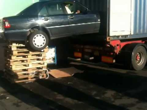loading a car into a container african style. Did they get it in ?