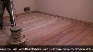 Hardwood floor refinishing: Buffing between coats of finish