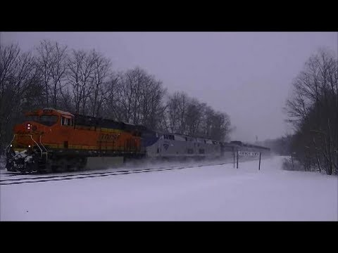 Thumbnail: BNSF freight unit leads Amtrak in a snow storm