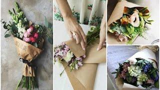 Смотреть видео Как упаковать букет цветов в крафт-бумагу. Мастер класс практической флористики.