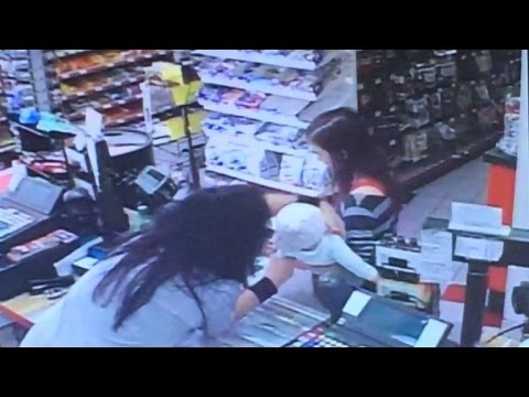 Watch Store Clerk Protect Baby When Mom Falls During Seizure
