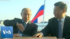 Vladimir Putin and Xi Jinping Take A Sunset Boat Ride