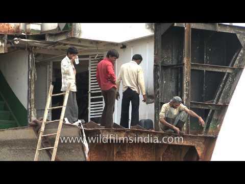 Scrap business: Workers at Alang ship-breaking yard, Gujarat
