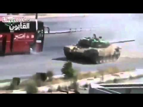 09 12 2013 SRY WAR Syrian Tank Protecting Civilian Bus Under Fire Syria war