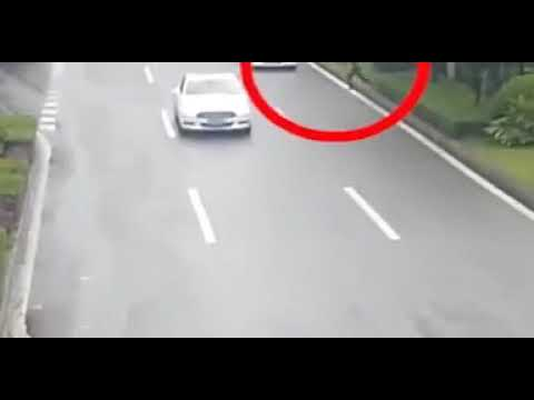 Woman narrowly misses being run over by two cars trying to catch bus