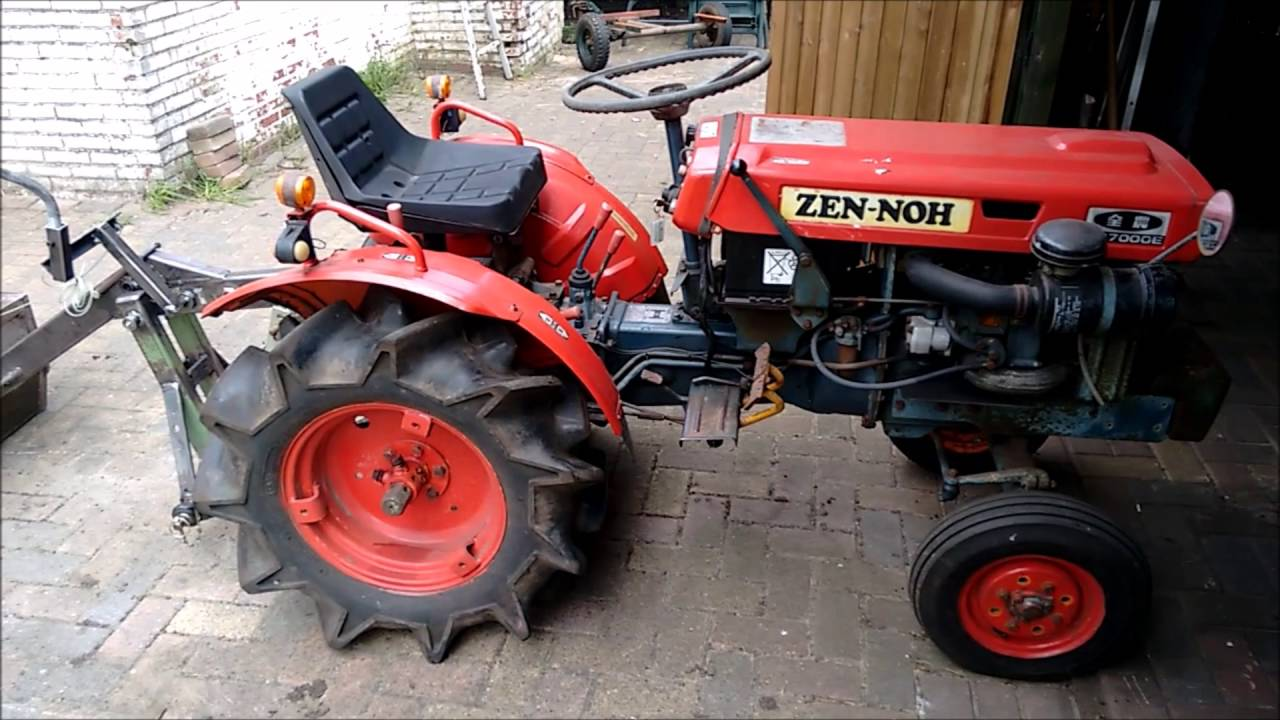 Kubota B7000 rear end loader Part 2 (detail locking mechanism dump bucket)  by Marcel Herwijnen