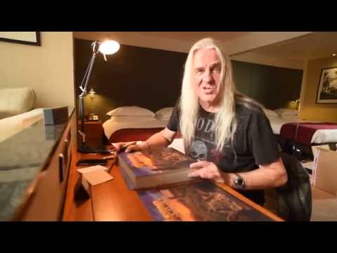 Watch Biff Byford Signing Exclusive Paul Gregory Prints for Saxon Vinyl Hoard