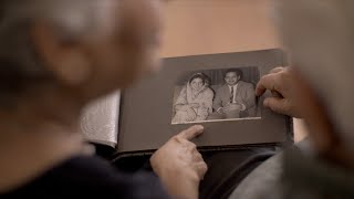 Elderly Indian couple checking their old wedding album pictures