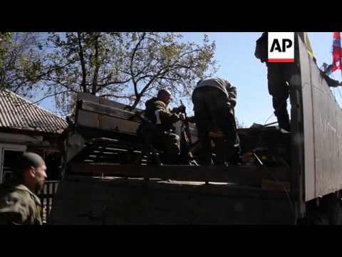 Pro-Russian rebels fight and rescue bodies of fellow fighters in Donetsk airport