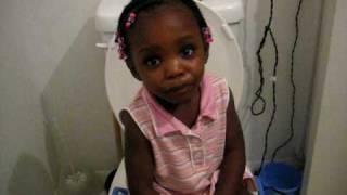 Triniti playing on the potty