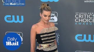 Margot Robbie dazzles in black and gold dress at Critics' Choice - Daily Mail