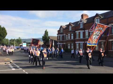 Parade past Ardoyne shops and Mountainview 2017