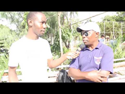 Oshwal Academy Mombasa Coach (Tom ) on his team