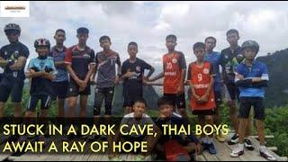 Stuck in a dark cave, Thai boys await a ray of hope