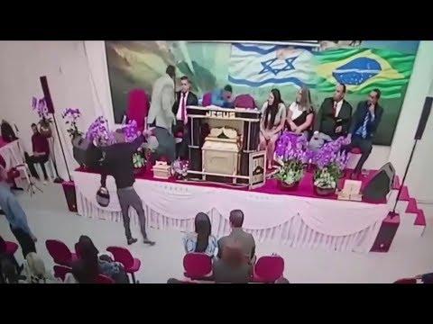 The terrifying moment a gunman opens fire on a Brazilian church