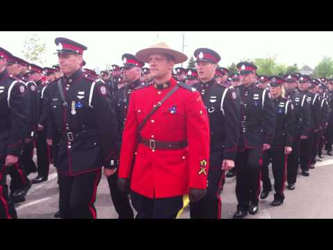 RCMP, Police and Army all marching together to Moncton Coliseum