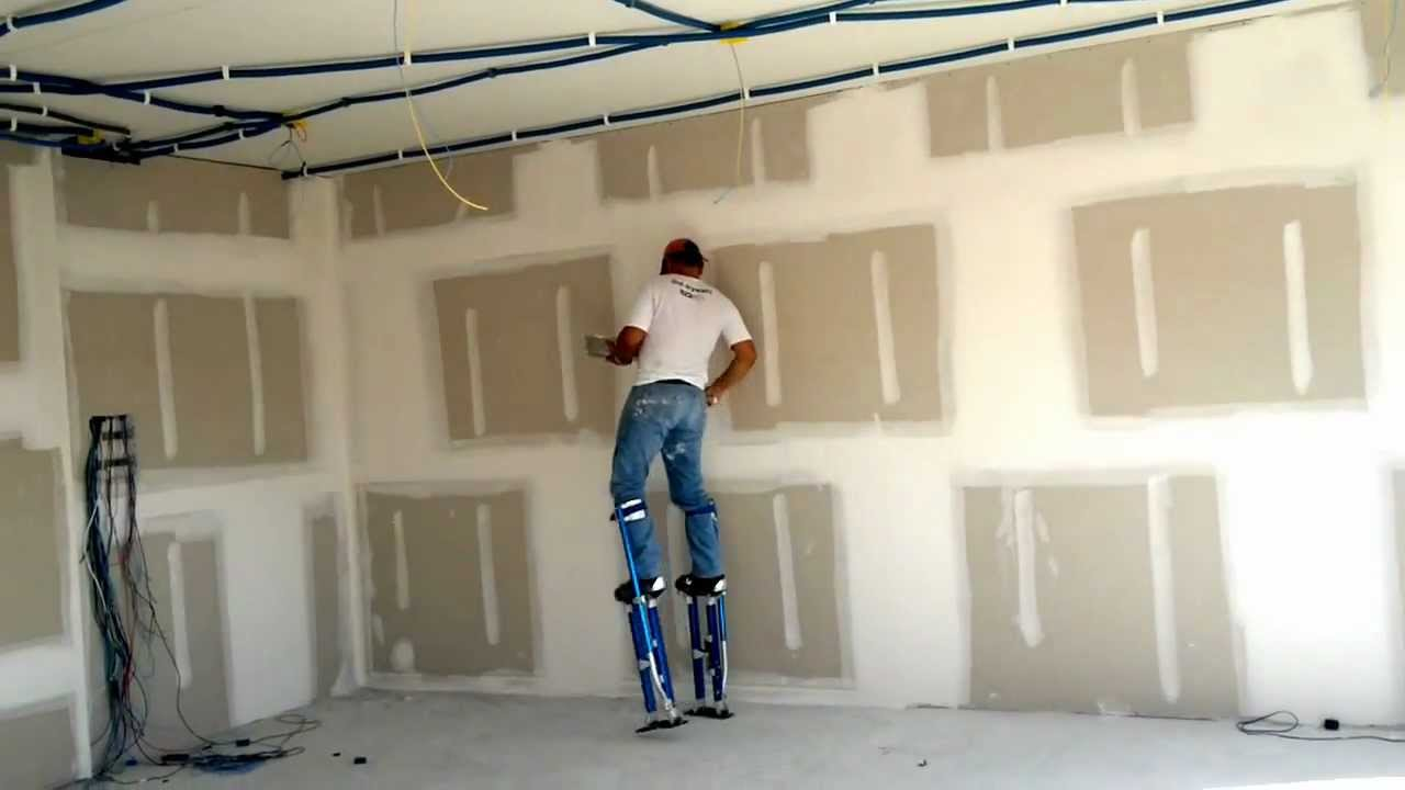 Finishing drywall stilts youtube for What is the best way to hang pictures on drywall