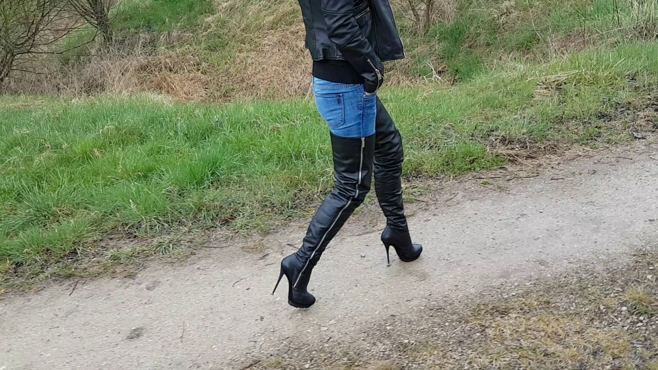 thigh high heel boots walk in a rainy day