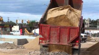 Red Dump Truck dumping a load of very fine dirt