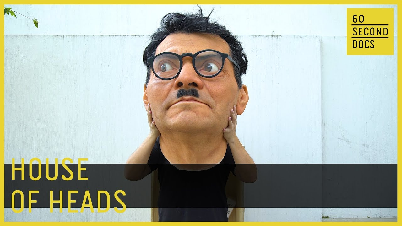 Giant Hyper-Realistic Head Sculptures